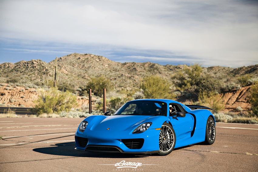 Blue Porsche 918 parked